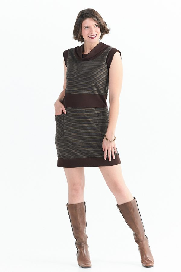 tall model wearing short sleeve brown dress with pockets and she is wearing boots.