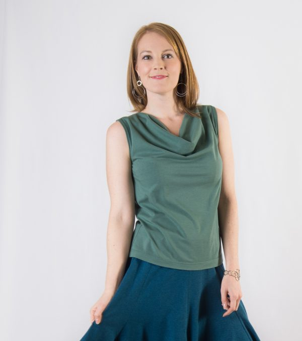 Cowl neck top in soft green on lady with red hair