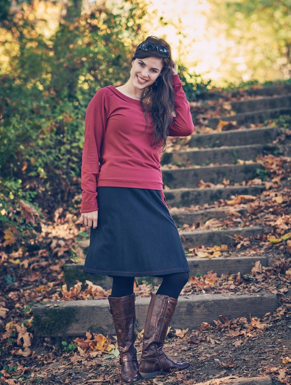 Alysse in a hemp Robot Skirt on some steps with trees and fall leaves