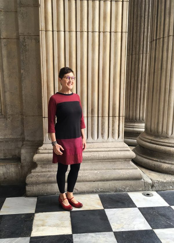 lady in red and black dress with black tights and red shoes in london