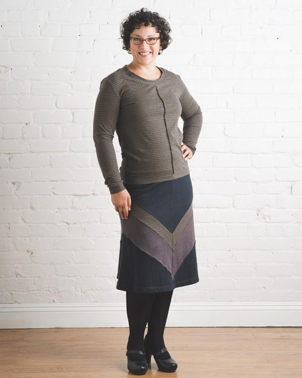 Model in brown and black sustainable fashion chevron skirt