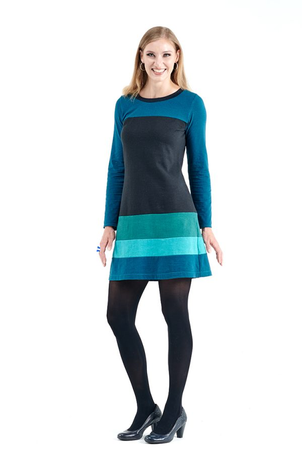 model in hemp and organic cotton dress with long sleeves and layers of blues and black torso fabric.