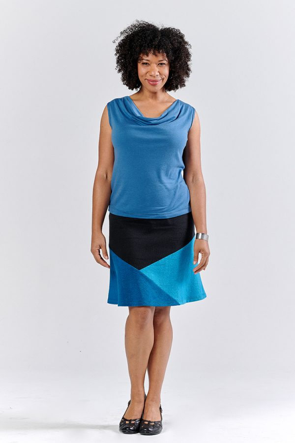 Beautiful woman in blue and black geometric hemp skirt and blue sleeveless cowl neck top