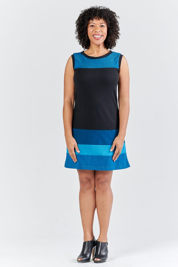 pretty lady in sleeveless hemp and organic cotton dress with stripes of blues and black