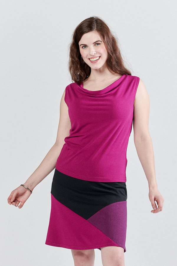 bright fuchsia cowl neck sleeveless top and crystal skirt on smiling actress