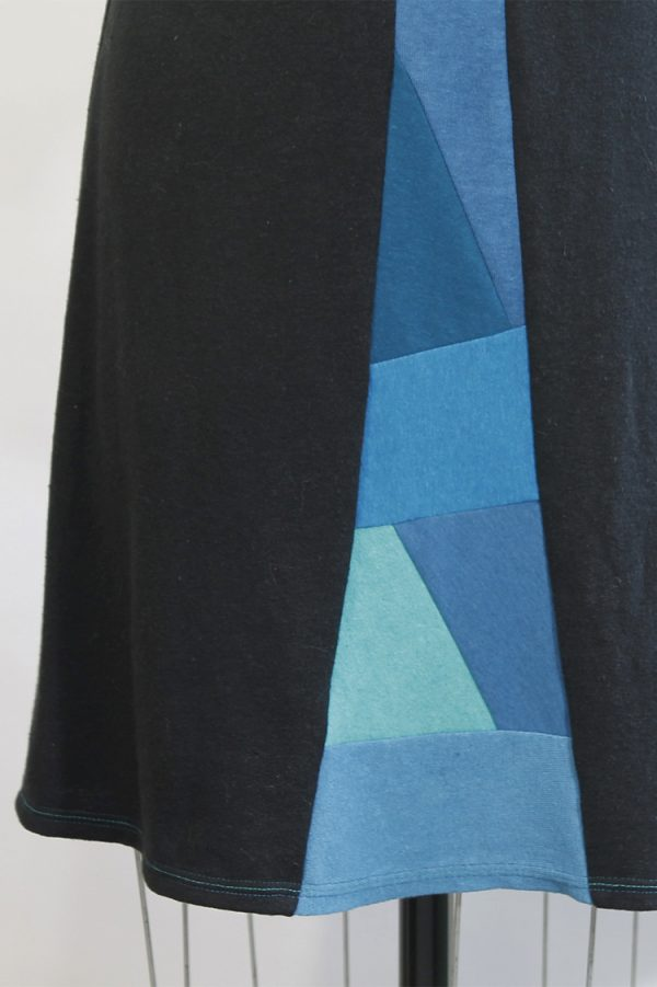 closeup of blue collage with geometric shapes going in every direction