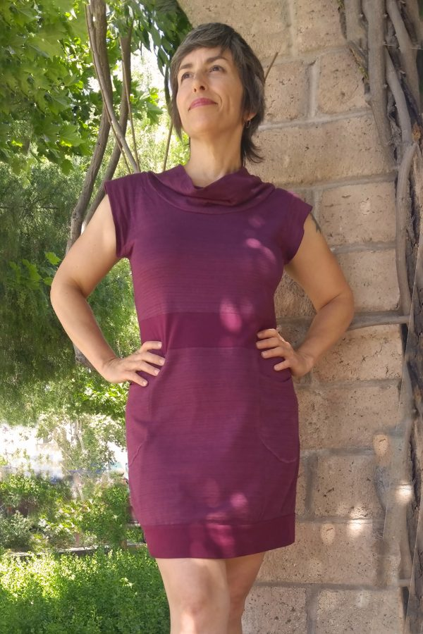 Huckleberry hemp dress with pockets on lady standing boldly with hands on hips