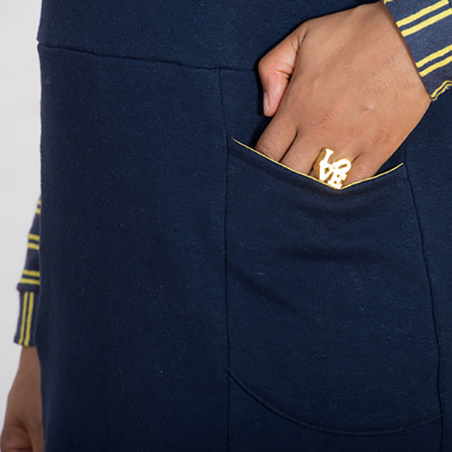 hand in dress pocket with gold LOVE ring