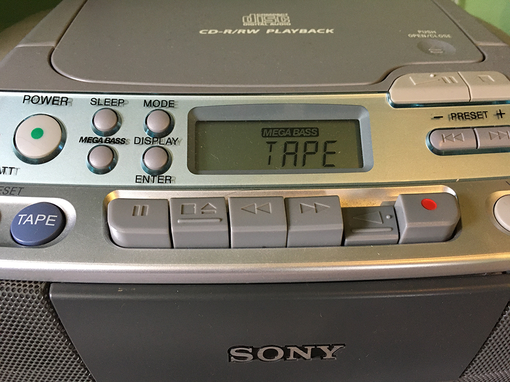 closeup of old school tape player with the button PLAY pressed