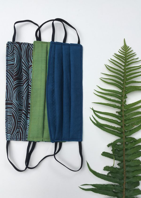 cloth face masks in brown swirl, leaf green and ocean blue organic cotton with a fern