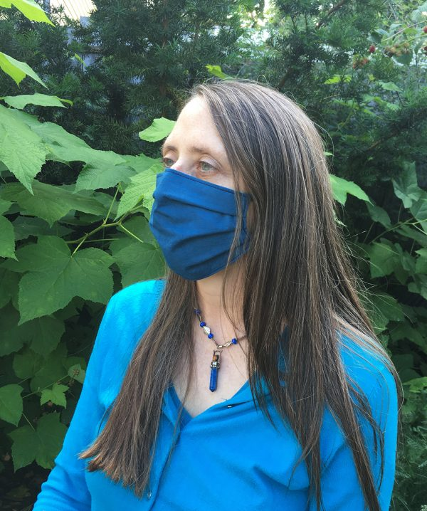 blue cotton face mask on lady side view in garden
