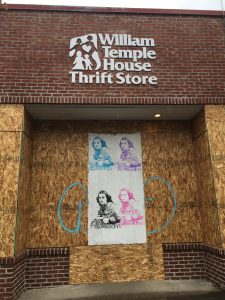 William Temple House Thrift Store front with plywood boarding up the windows