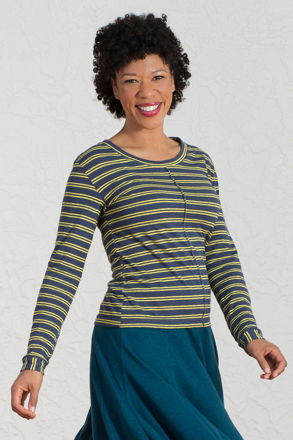 beautiful black model wearing a yellow and blue striped long sleeve hemp top and a big smile