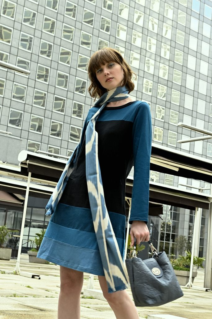 Vivid Element blue and black poppy dress on a lady in Paris with blue eye shadow, long scarf and purse