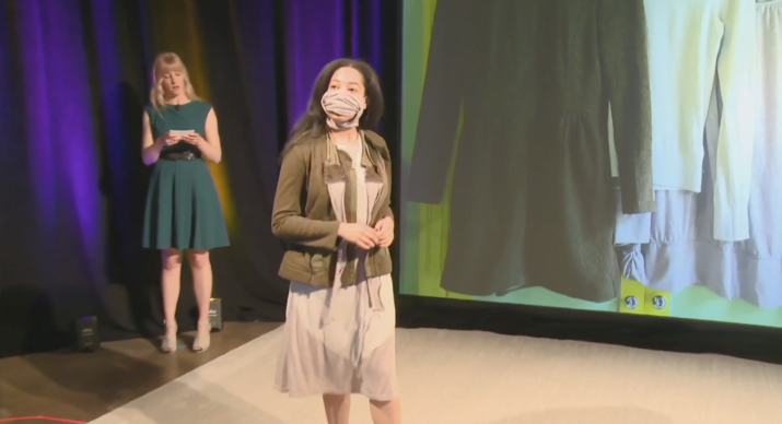 model wearing a mask, jacket and dress created from second hand clothing for the william temple fundraiser fashion show