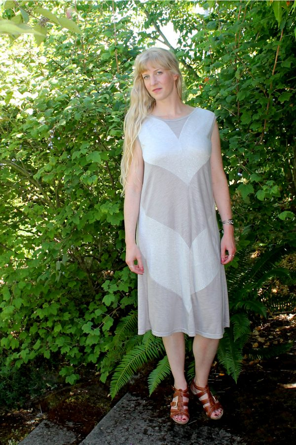 model in flowy dress made from upcycled fabrics