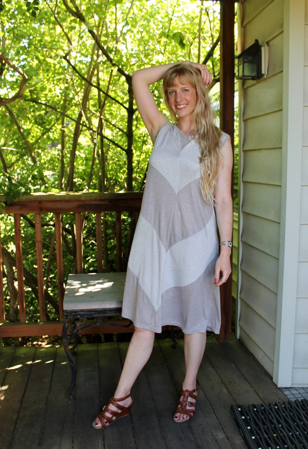 model on porch with sleeveless dress