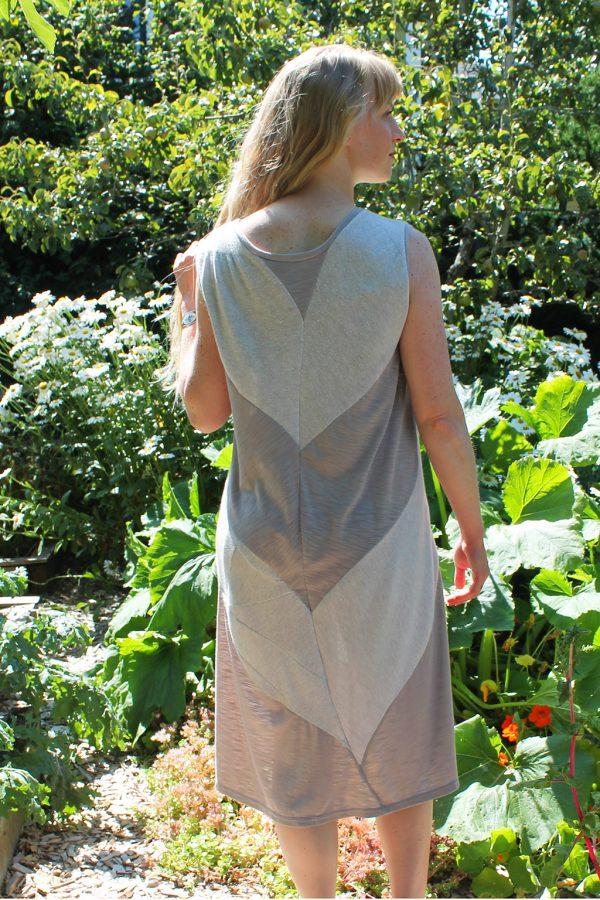 back of model in arugula flower dress out in garden