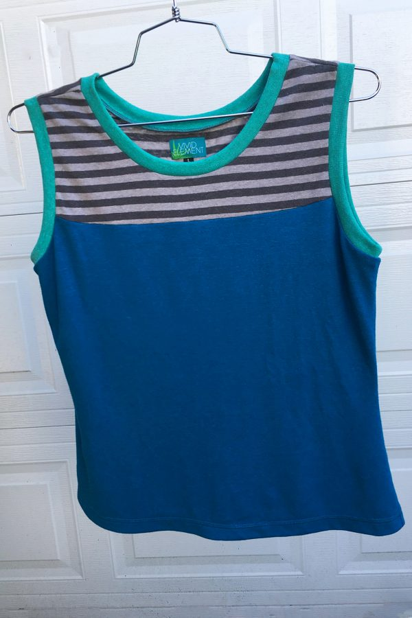 tank top with a turquoise body and top section in grey stripes with aqua ribbing around neck and arm sythes. top is on a hanger.