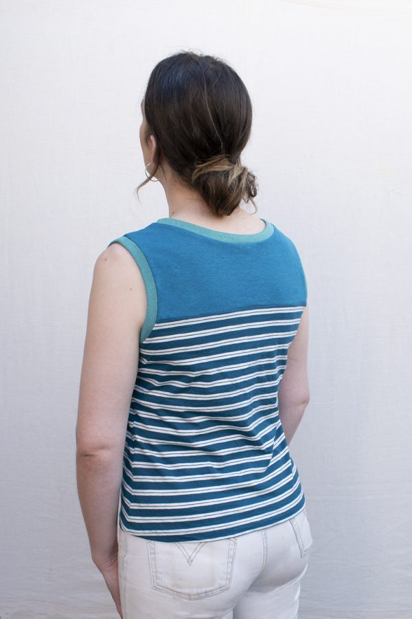 blue and white striped tank top on model, showing back.