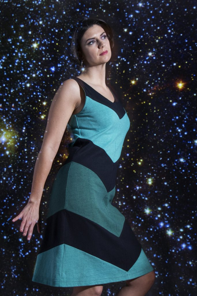 model in blue and black chevron sleeveless hemp dress with stars in the background