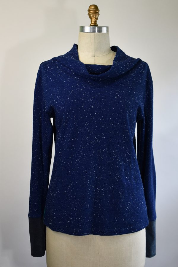 blue long sleeve top with grey velour cuffs and a cowl neck, dispayed on a dress form