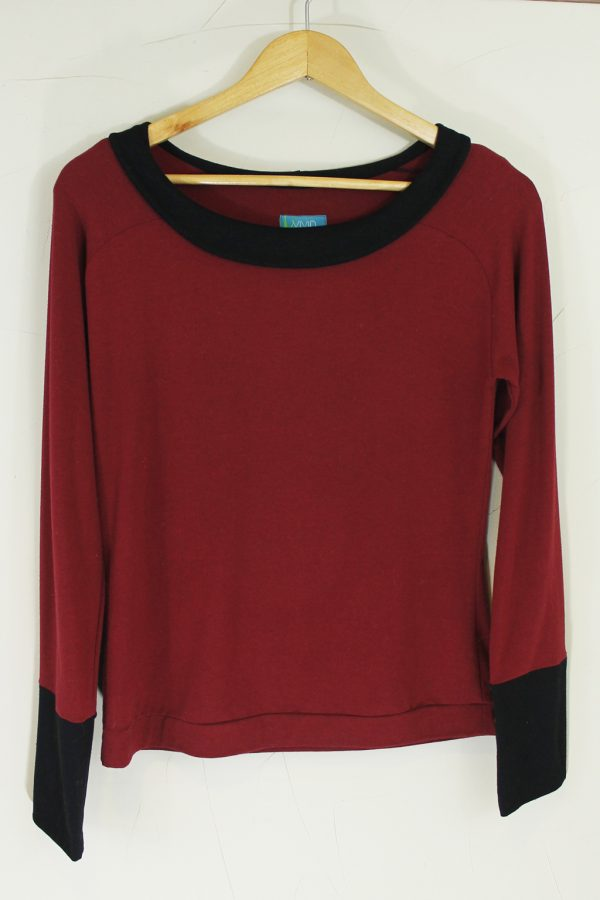 long sleeve red organic fabric top with black cuffs and black collar